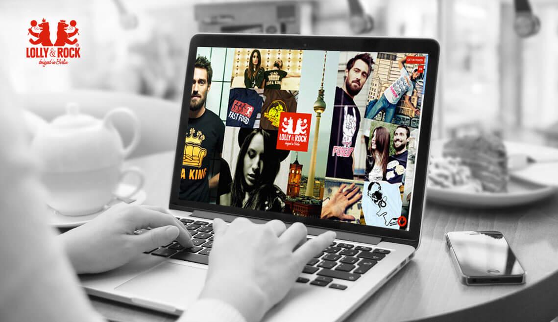 Webdesign aus Essen von mediadesign linke - Ansicht eines Cafes mit Tisch und Person an Laptop, die responsive Website von Lolly&Rock ist sichtbar
